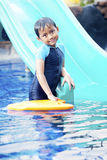 Cute Asian Kid Posing at Swimming Pool Stock Image