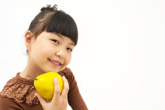 Cute asian kid with a quince Royalty Free Stock Photos