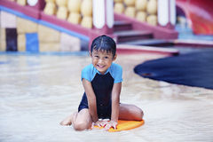 Cute  Asian Kid smiling at swimming pool Royalty Free Stock Photo