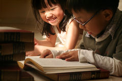 Cute asian kids. 2 little kids doing homework royalty free stock images