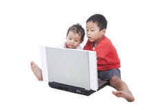 Cute asian kids with computer stock photo