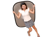 Cute asian lady with reflector in white background Royalty Free Stock Photography