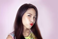 Cute asian lady smile with pink lipstick on studio shot royalty free stock image