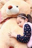 Cute Asian little beautiful girl Lying on the toy. Smile looking Royalty Free Stock Images
