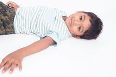 Cute asian little boy lying on floor. Asian little boy lying on floor Royalty Free Stock Photo
