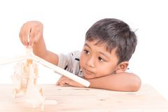Cute asian little boy play plane toy wood. Asian little boy play plane toy wood Royalty Free Stock Photography
