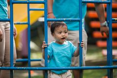 Cute asian little boy. Portait of handsome asian little boy smiling while playing in the playground Royalty Free Stock Photography