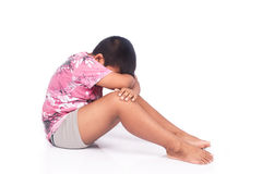 Cute asian little boy sad and strain. On white background Royalty Free Stock Photo