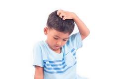 Cute  asian little boy scratching head. Cute child asian little boy scratching head Royalty Free Stock Photography