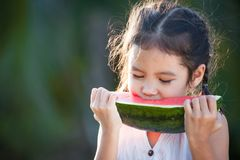 Cute asian little child girl eating watermelon fresh fruit Royalty Free Stock Photography