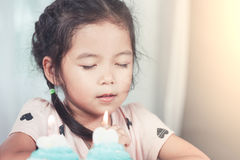 Cute asian little child girl make folded hand to wish Royalty Free Stock Photography