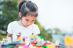 Cute asian little child girl playing with colorful toy blocks Royalty Free Stock Photos