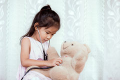 Cute asian little child girl with stethoscope playing doctor Stock Photo