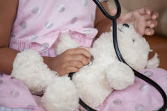 Cute asian little child girl with stethoscope playing doctor Stock Images