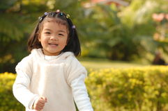 Cute Asian little girl. Playing in a park Stock Images