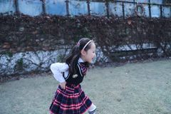 Cute Asian little beautiful girl run in the park stock images