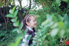 Cute Asian little beautiful girl smell flower Stock Photos