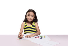Cute asian little girl drawing with colorful crayon Stock Images