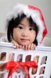 Cute asian little girl in a santa hat Stock Photos