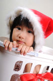 Cute asian little girl in a santa hat Royalty Free Stock Photo