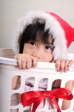Cute asian little girl in a santa hat Stock Photo