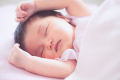 Cute asian newborn baby girl sleeping in bed Royalty Free Stock Photo
