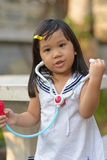Cute Asian play a doctor. Cute Asian like to play a doctor Royalty Free Stock Photography