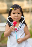 Cute Asian play a nurse Stock Photos