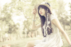 A cute Asian Thai girl is looking in the sky with hope in natura Royalty Free Stock Image