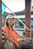 Cute Asian Thai girl is relaxing in the pavilion near he riversi Royalty Free Stock Images