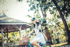 Cute Asian Thai girl in vintage clothings is riding a bicycle, i Royalty Free Stock Photo
