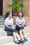 Cute Asian Thai high schoolgirls student couple happy chatting stock photos