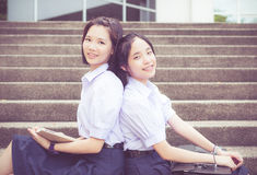 Cute Asian Thai high schoolgirls student couple leaning Stock Photo