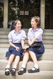 Cute Asian Thai high schoolgirls student couple in school Royalty Free Stock Images