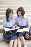 Cute Asian Thai high schoolgirls student couple in school Stock Photography