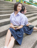 Cute Asian Thai high schoolgirls student couple in school stock photos