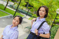 Cute Asian Thai high schoolgirls student couple in school uniform standing with her friend in a happy smile face in nature Royalty Free Stock Photography