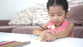 Cute asian Thai little girl drawing stock video footage