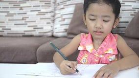 Cute asian Thai little girl drawing stock video