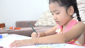Cute asian Thai little girl drawing stock footage