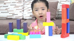 Cute asian Thai little girl playing brick stock video footage