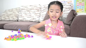 Cute asian Thai little girl playing brick stock footage