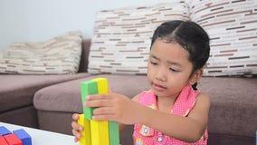 Cute asian Thai little girl playing brick stock video