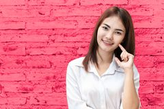 Cute asian thai teen girl smile finger at cheek pink background royalty free stock photos