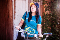 Cute Asian Thai Woman Traveller with a bicycle Royalty Free Stock Photo