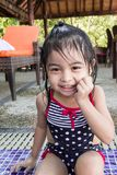 Cute asian toddlers twins portrait shot smiling while playing on waters of a swimming pool in a resort. In asia royalty free stock image