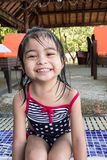 Cute asian toddlers twins portrait shot smiling while playing on waters of a swimming pool in a resort. In asia royalty free stock photos