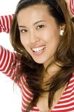 Cute Asian Woman. An attractive asian model in red on white background royalty free stock photo