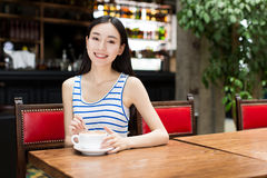 Cute asian woman drinking coffee Stock Photography