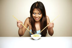 Cute Asian woman eating Stock Photo